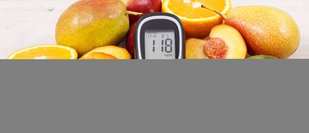 Glucometer for checking sugar level and fresh healthy nutritious food as source natural vitamins and minerals, diabetes concept Stok Fotoğraf - 132079804