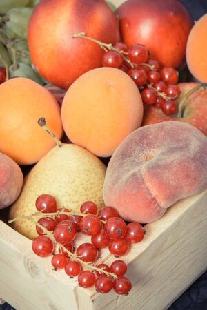 Heap of fresh fruits in wooden box as healthy snack or dessert containing natural vitamins and minerals