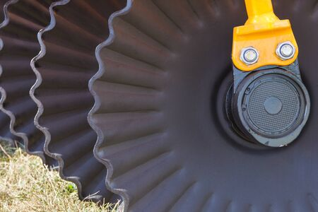 Black part and detail of agricultural disk harrow Stock Photo - 133666006