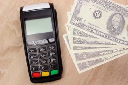 Currencies dollar and credit card reader, payment terminal, finance and banking concept