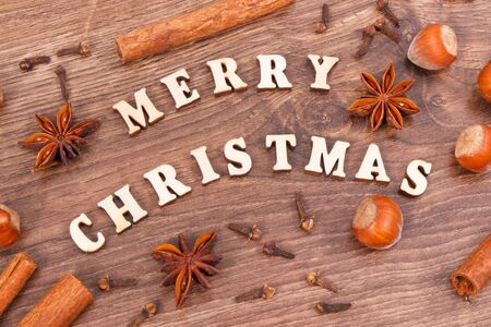 Ingredients with spices for baking and inscription Merry Christmas, decoration for festive time