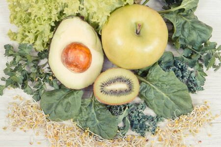 Fresh ripe natural fruits with vegetables and sprouts. Nutritious food containing healthy minerals and vitamins