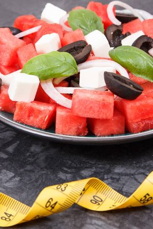 Fresh prepared summer salad of watermelon and feta cheese as source healthy natural vitamins and minerals