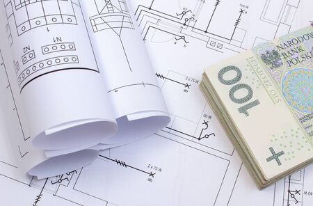 Polish currency money on electrical construction drawing of house. Concept of building house Stock Photo