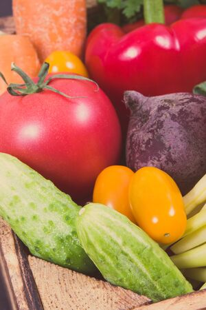 Fresh vegetables in wooden box as healthy snack containing natural minerals and vitamins