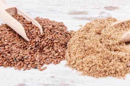 Linseed on old rustic board. Healthy food containing natural vitamins, dietary fiber and acids omega Stock fotó