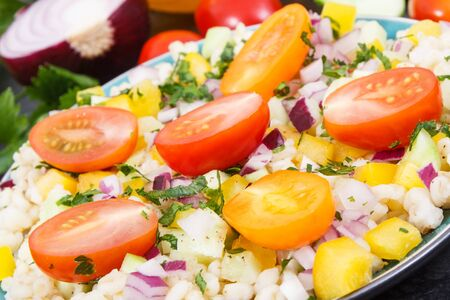 Fresh prepared salad with bulgur groats and vegetables. Healthy lifestyles and nutrition concept