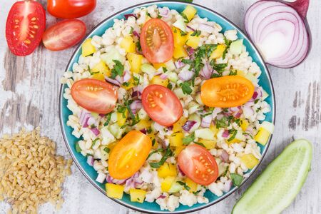 Fresh salad with bulgur groats and vegetables as best food for dieting and slimming. Source minerals and vitamins Zdjęcie Seryjne
