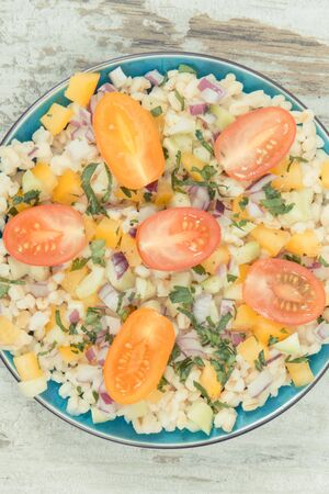 Fresh prepared salad with vegetables and bulgur groats. Healthy meal containing natural vitamins and minerals