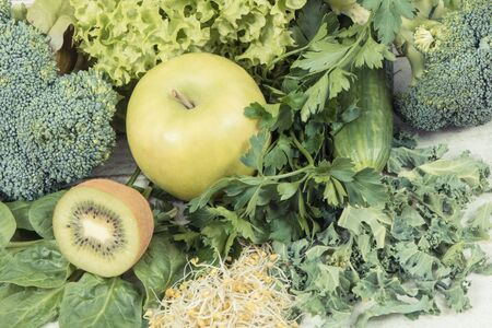 Fresh natural ripe green fruits with vegetables and sprouts. Concept of healthy nutrition, slimming and dieting