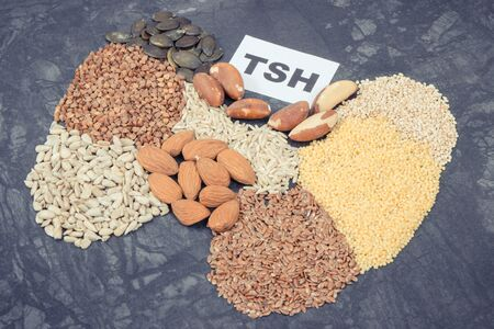 Inscription TSH and thyroid shape made of healthy ingredients. Source natural vitamins and minerals