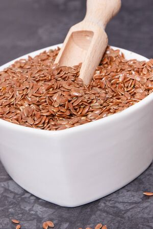 Linseed in white glass bowls as healthy food containing natural vitamins, dietary fiber and acids omega