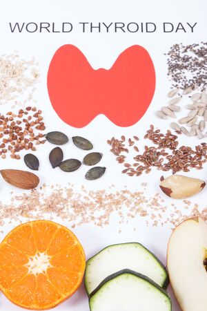 Nutritious ingredients and inscription World Thyroid Day on white background. Healthy food containing natural vitamins. Problems with thyroid concept