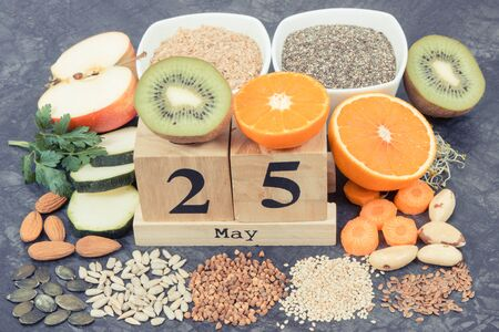May 25 on cube calendar and best nutritious food for healthy thyroid. World Thyroid Day concept Stock Photo