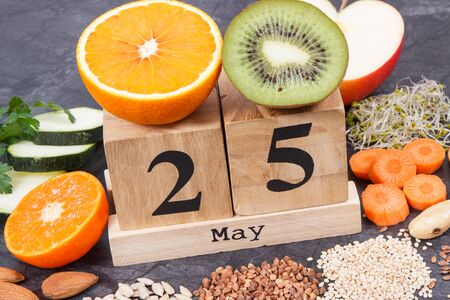 Cube calendar with date of World Thyroid Day and best food containing natural minerals and vitamins for healthy thyroid Stock Photo