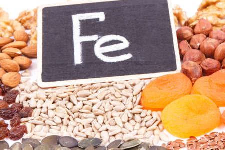 Inscription Fe and food containing iron, concept of healthy nutrition as source natural minerals, vitamins and dietary fiber Reklamní fotografie