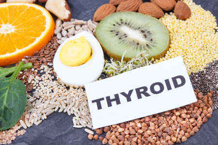 Fresh nutritious ingredients, fruits and vegetables for healthy thyroid. Food as source natural vitamins and minerals Stock Photo