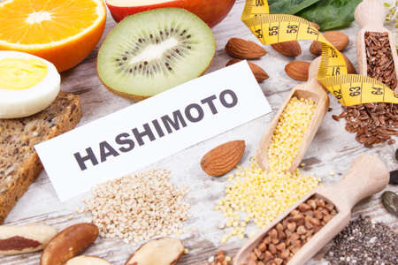 Inscription hashimoto, centimeter and best nutritious food for healthy thyroid. Dieting and slimming concept Reklamní fotografie