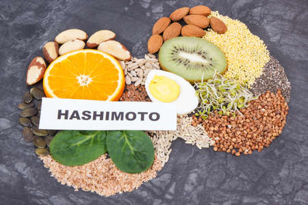 Nutritious natural ingredients in shape of thyroid. Healthy food containing vitamins and minerals. Problems with thyroid concept