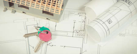 House under construction, home keys and electrical diagrams for use in engineer jobs, building home concept