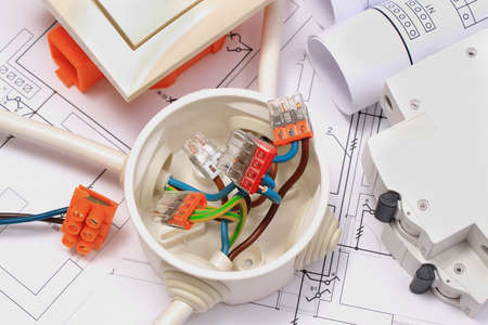 Components and accessories for electrical installations and construction diagrams of house Foto de archivo