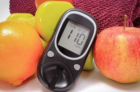 Glucose meter for checking sugar level, fresh ripe fruits and dumbbells using in fitness. Healthy nutrition and sporty lifestyles during diabetes