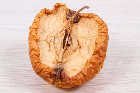 Old wrinkled moldy and disgust apple, concept of unhealthy fruit