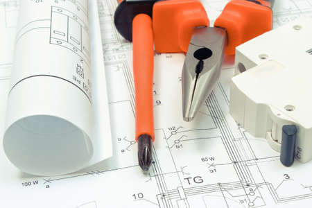 Electrical diagrams, electric fuse and work tools on construction drawing of house. Building home concept. Drawings for projects engineer jobs