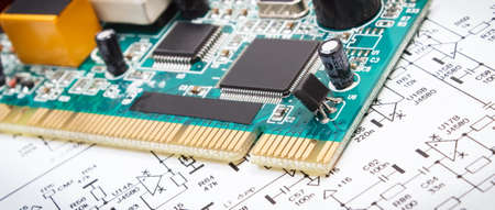 Printed circuit board with transistors, resistors, capacitor. Diagram of electronics. Technology