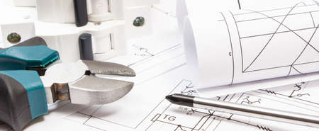 Work tools, electric fuse and diagrams of plan with electrical installation. Building home concept