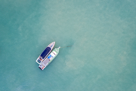 Top view speed boat parked in the sea at Chalong bay, Phuket province, Thailand. Aerial view from flying drone