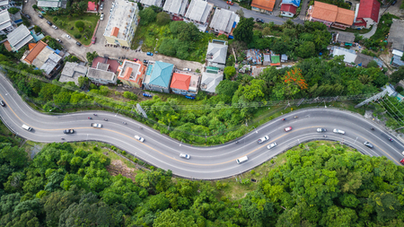 Top view car and road on the hill in Phuket, Thailand. Aerial view from flying drone Stock Photo