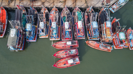 Aerial view of the big fishing boats standing at the sea in Phuket, Thailand