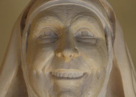 carmelite nun: Nun stone face Stock Photo