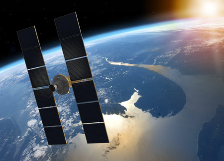 3D render of a space satellite with solar panels orbiting planet Earth facing the Sun