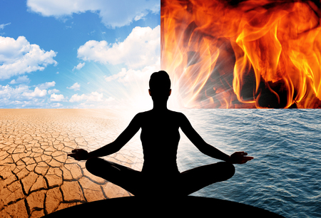Concept of Yoga and the four elements of the Universe, fire, water, earth, and air. They make up all that is, everything we see around us, and everything we are.  版權商用圖片