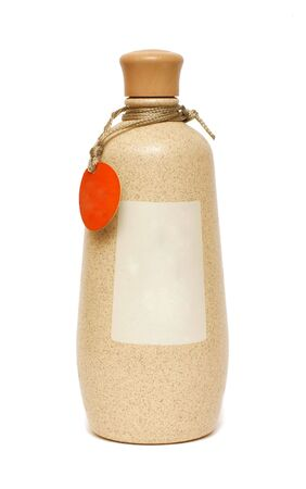 Clay bottle on a white background close up photo