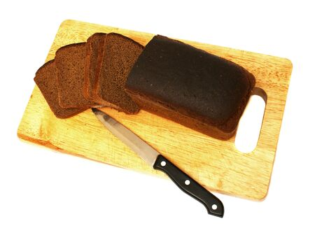 Black bread isolated on a white background close up photo