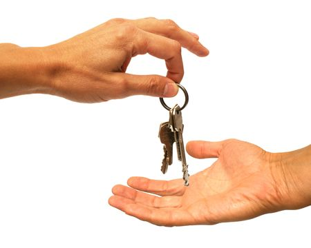 Two hands and keys on a white background photo