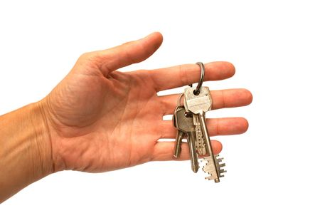 hand and keys on a white background photo