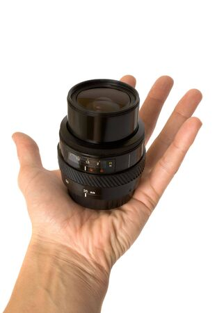 Photographic objective in a hand Stock Photo - 5834962