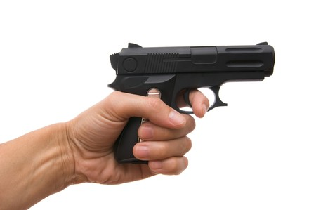 gun fire: Black pistol in a hand on the white Stock Photo
