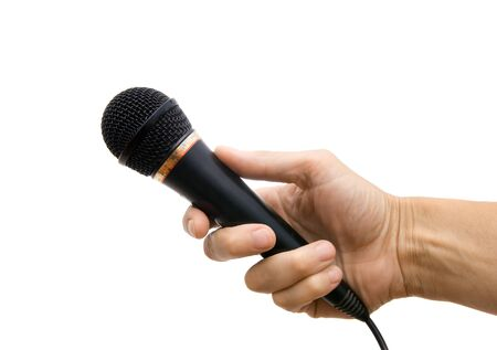 Microphone in a hand on a white background photo