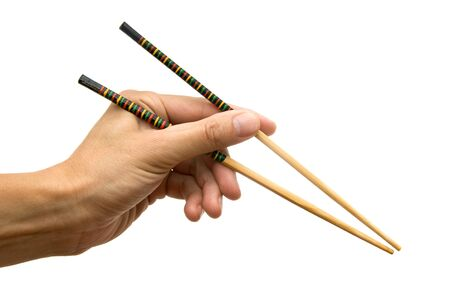 Chopsticks in a hand