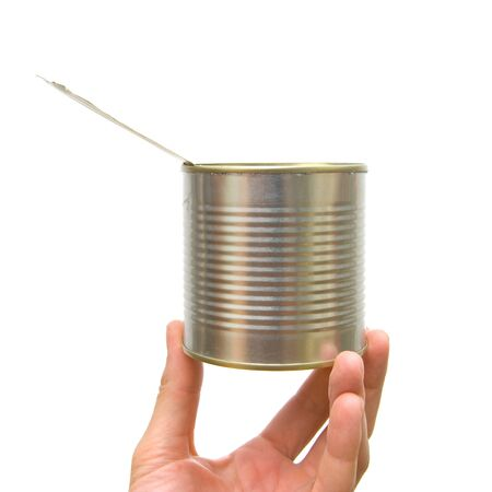 tin: Metal can in a hand on a white background Stock Photo