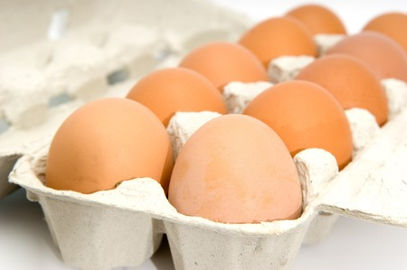 Eggs in cardboard packing on a white background photo
