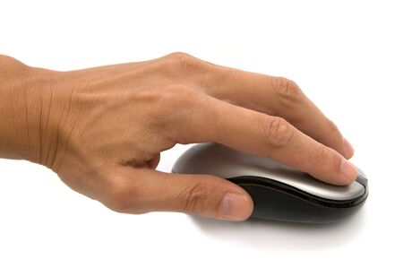 The computer mouse in a hand on a white background Stock Photo - 7497814