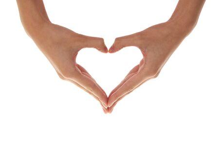 corazon en la mano: Coraz�n de manos sobre un fondo blanco