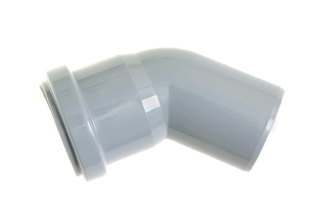 Plastic sewer tube on a white background photo
