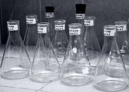 Photo of glass chemical flasks close up photo
